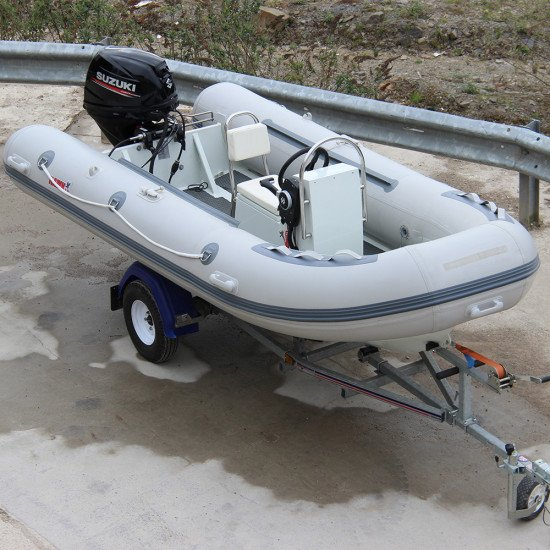 3.8m Iroquois RIB boat front view with trailer and engine mounted