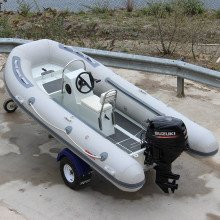 3.8m Iroquois RIB boat back view with trailer and engine mounted