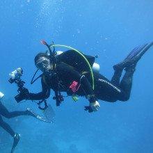 Underwater photograph of Northern Divers Delta Flex Semi-Tech Wetsuit in action